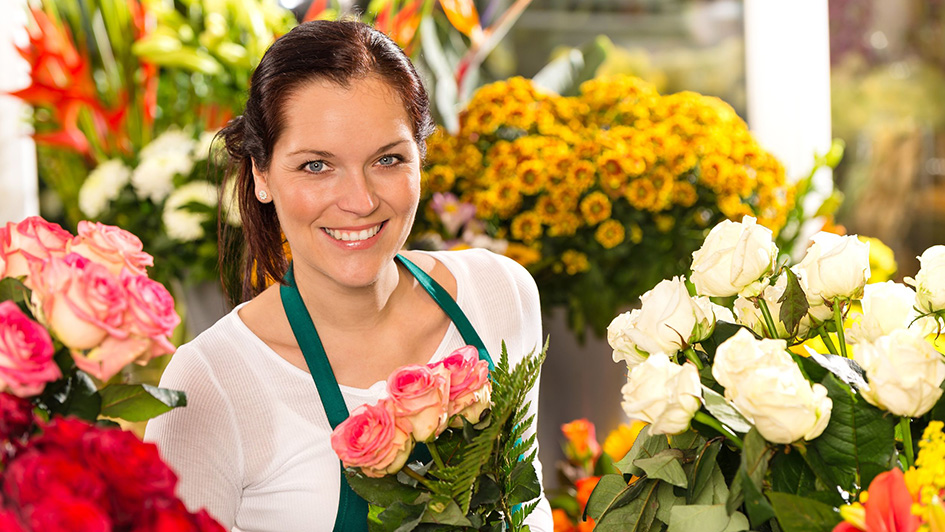 happy-florist-with-flower-backdrop
